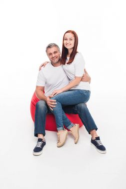 Couple in bean bag chair