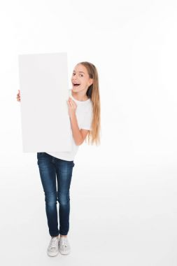 Excited adorable female child holding empty board, isolated on white stock vector