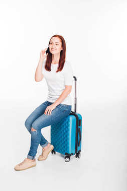 Happy female traveler with luggage using smartphone, isolated on white stock vector