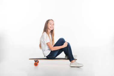 Little female skateboarder