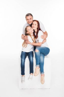 Happy hugging family