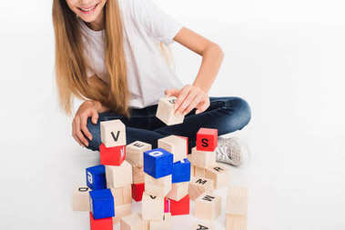 Child with alphabet blocks
