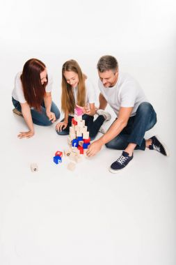 family playing with alphabet blocks