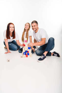 family playing with alphabet cubes