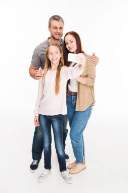 Family taking selfie on smartphone