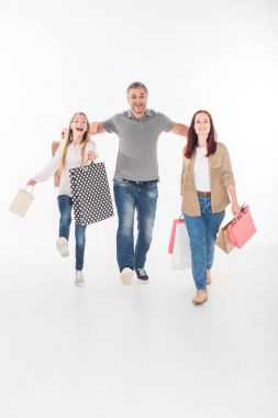 Young smiling family with shopping bags, isolated on white stock vector