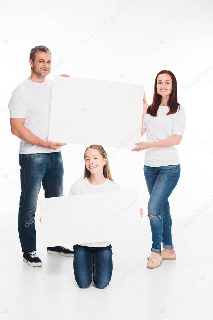 family holding empty boards