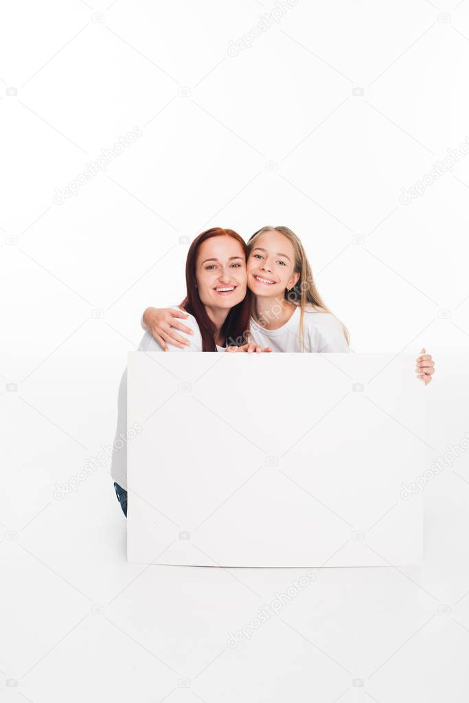 daughter and mother with empty banner