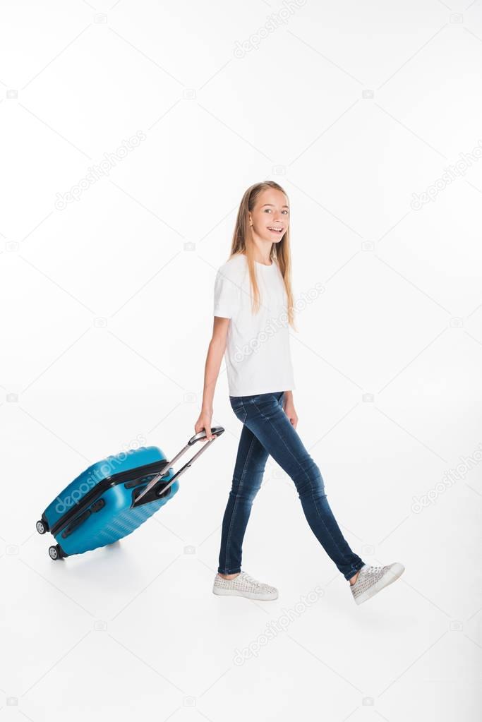 female child with luggage