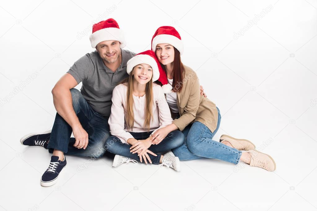 family in santa hats