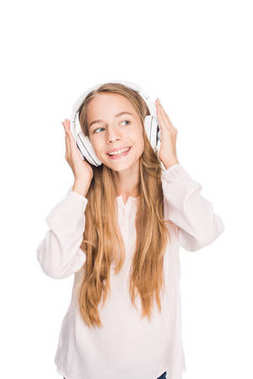 Happy teenager listening music with headphones, isolated on white stock vector