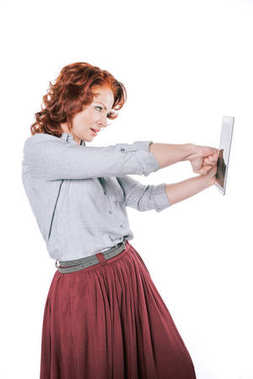 woman punching digital tablet
