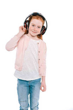 child listening music with headphones
