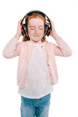 Smiling female child with closed eyes listening music with headphones, isolated on white stock vector