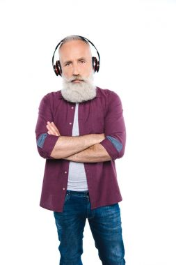 Senior man with headphones