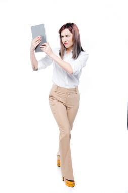 businesswoman looking at digital tablet
