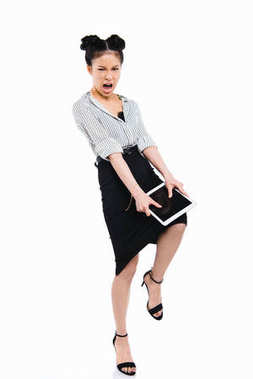 aggressive asian businesswoman with tablet