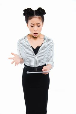 shocked businesswoman using tablet