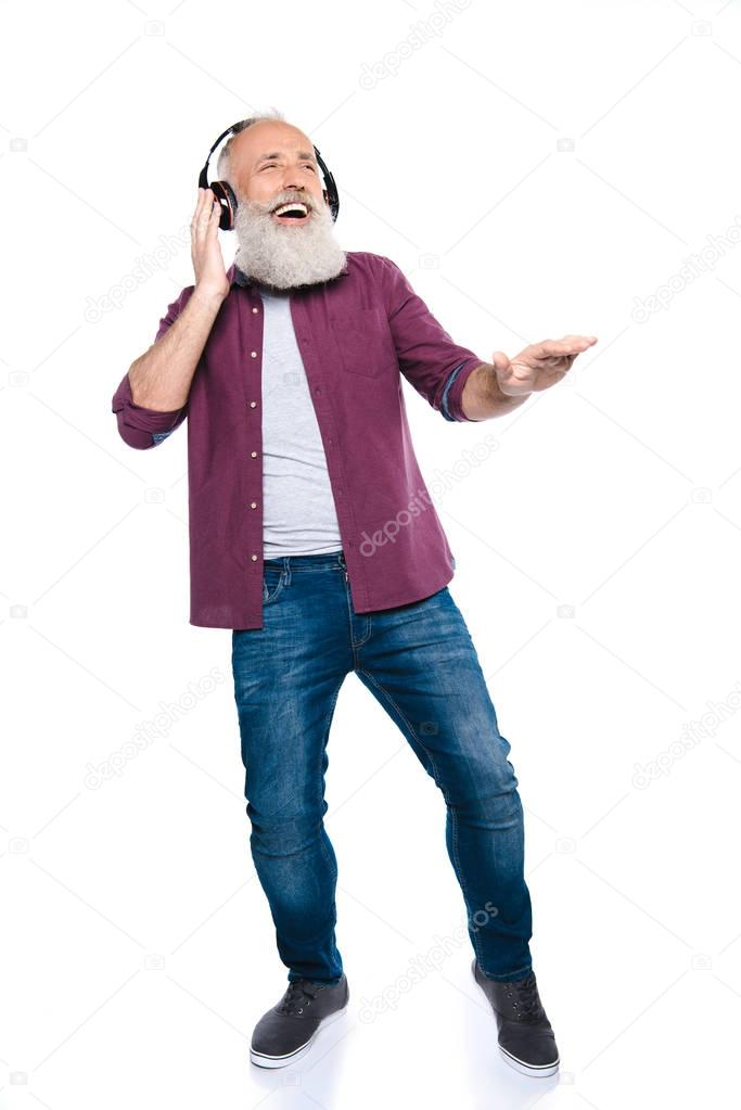 senior man dancing and listening music
