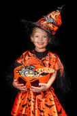 Photo little witch with halloween sweets