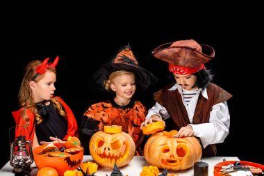 kids with halloween jack o lanterns