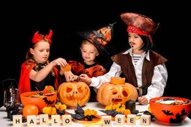 children with halloween jack o lanterns
