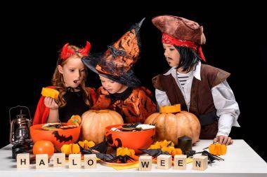 kids making halloween jack o lanterns