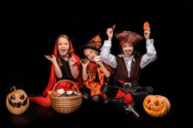 devil, witch and pirate with sweets