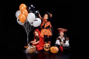 children with halloween balloons