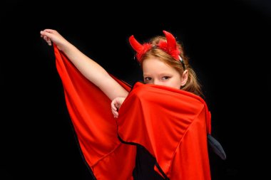 Kid in halloween costume of devil, isolated on black stock vector