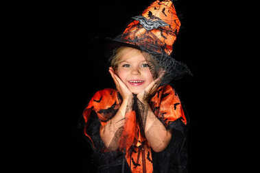 Smiling child in halloween costume of witch, isolated on black stock vector