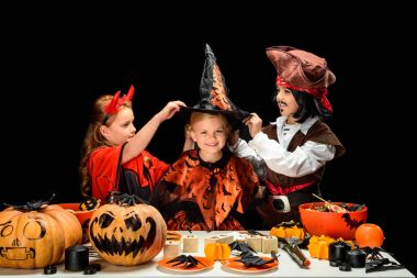 children in halloween costumes with sweets