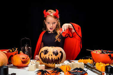 child with halloween jack o lantern