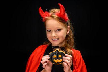 little devil with halloween pumpkin cookie