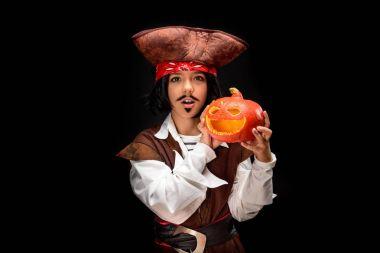 little pirate with halloween pumpkin
