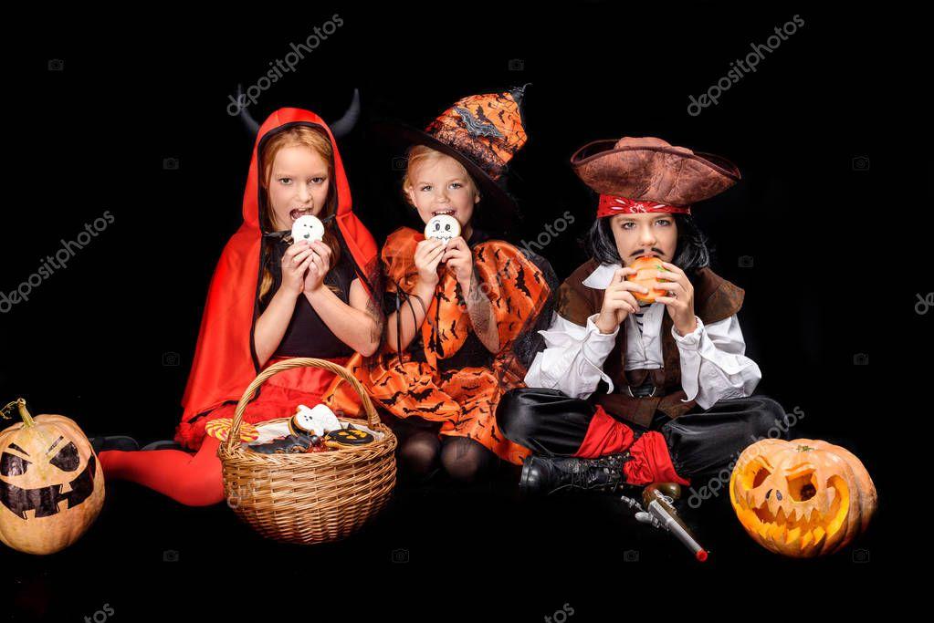 children with halloween sweets