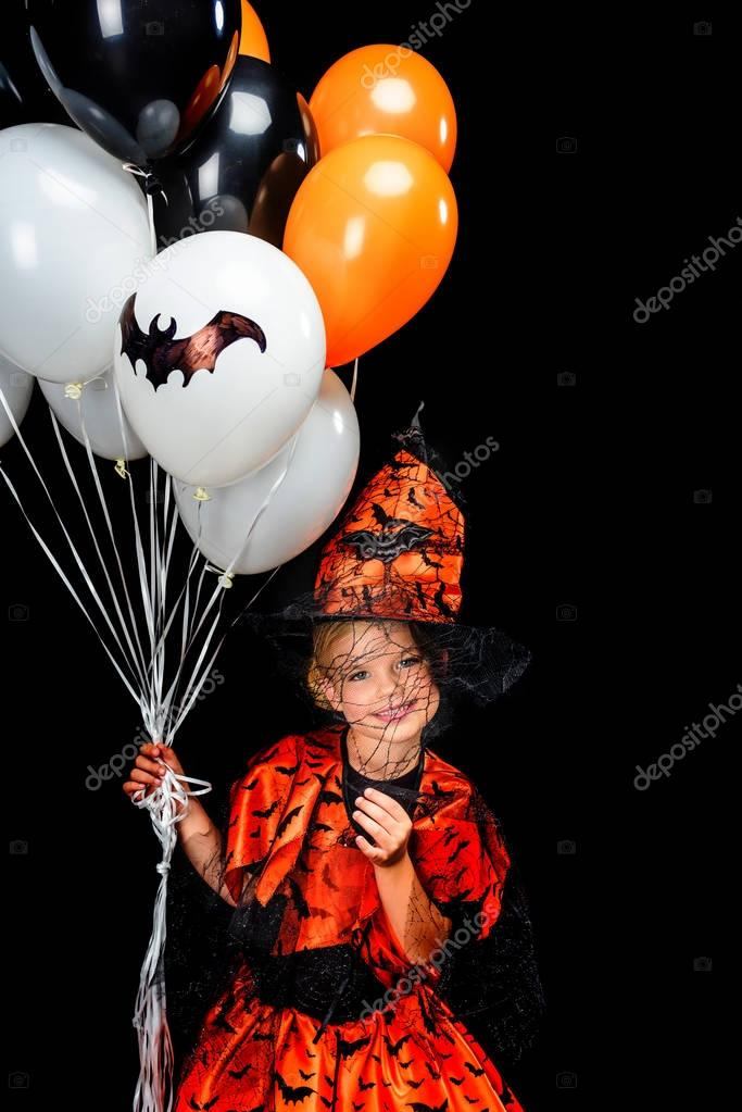 little witch with balloons