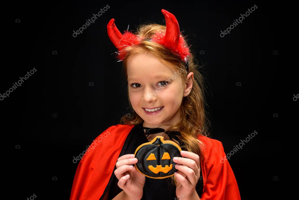 little devil with halloween pumpkin cookie