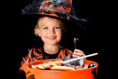 child with halloween sweets