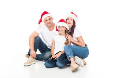smiling family in Santa hats