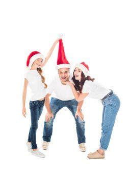 Happy family in Santa hats