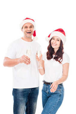 Couple in Santa hats with champagne