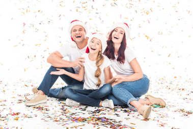 family with Christmas confetti