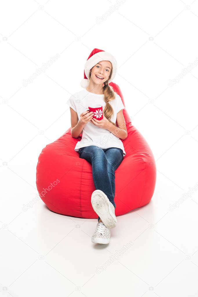 teenager in Santa hat with coffee