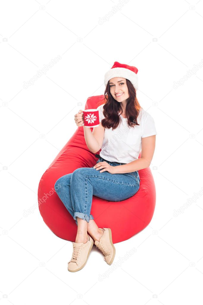 woman in Santa hat with coffee