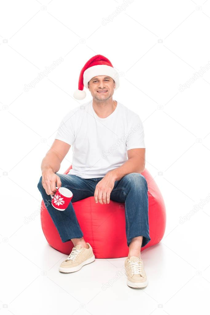 man in Santa hat with coffee