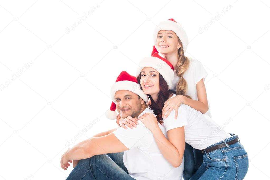 embracing family in Santa hats
