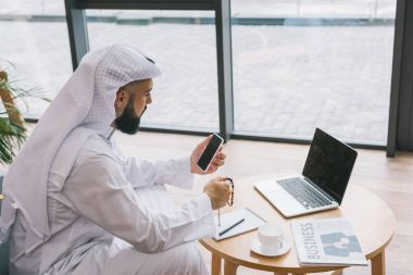 muslim businessman using smartphone