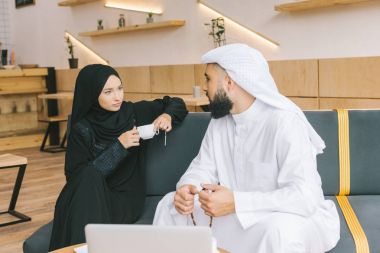 Muslim couple spending time in cafe