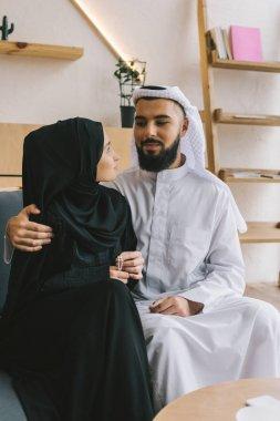 embracing muslim couple